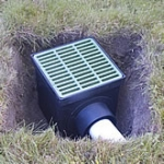 A drain box being installed.